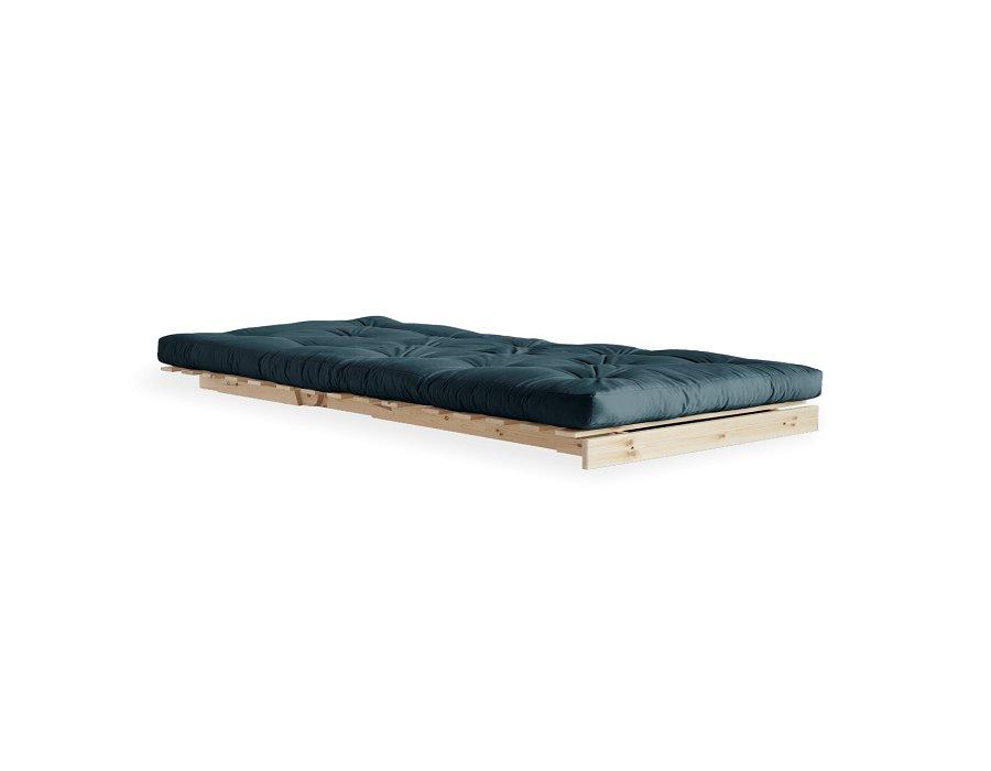 Fauteuil convertible futon RACINES pin naturel coloris bleu pétrole couchage 90 x 200 cm.